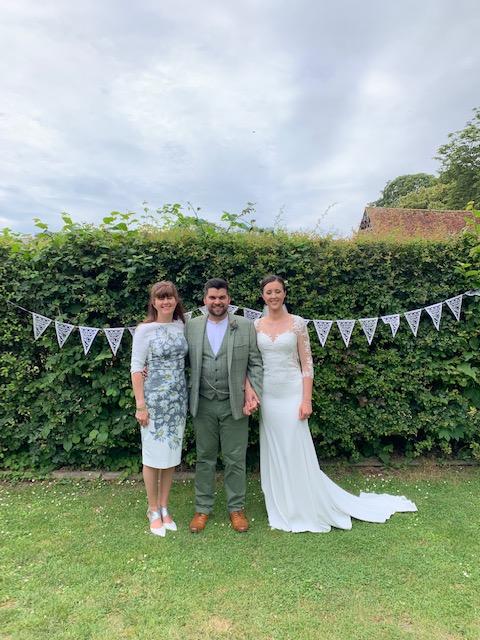 Rachel Head Humanist wedding celebrant with bride and groom in garden for Rachel Head Humanist Wedding Celebrant website
